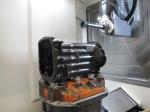 Essais d'usinage de surface de grande longueur sur des carters de transmission d'engin agricole sur la DMU 100 P.